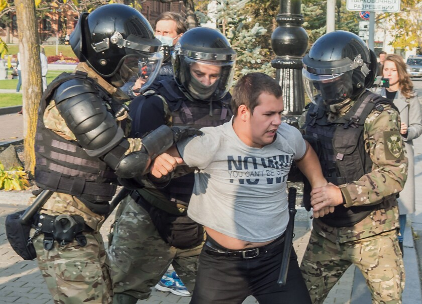 Police in riot gear detain a protester Saturday during a rally in Khabarovsk, Russia.