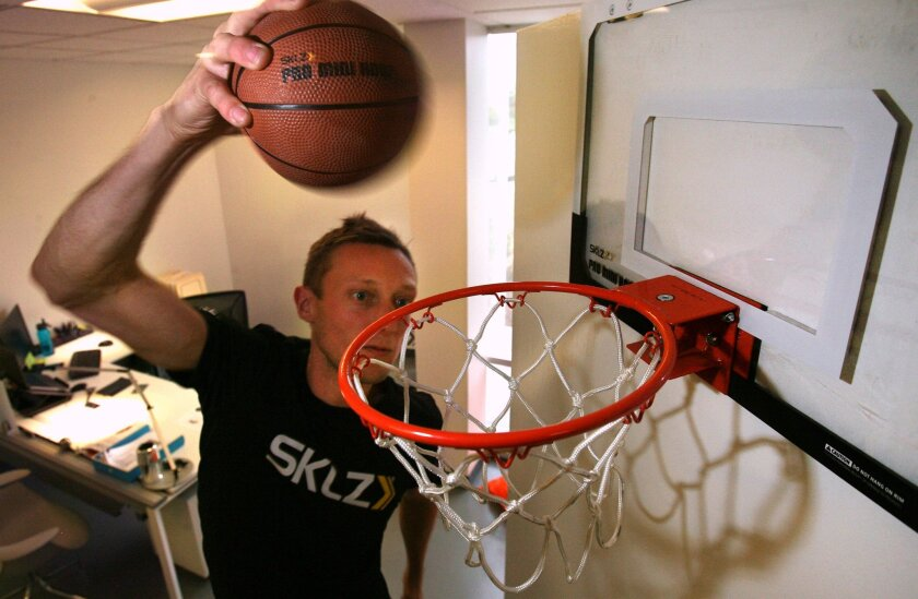 Allen Holland, director of product design at SKLZ in Carlsbad, demonstrates the company's Pro Mini Hoop. As soon as the product started doing well in the U.S. — the company has sold about 1.5 million units — along came the copycats. Bill Wechter