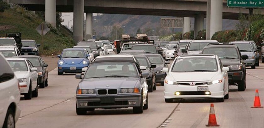 Traffic is backed up as it approaches a traffic collision on northbound Interstate 5, just north of Highway 52 in La Jolla, July 29, 2010.
