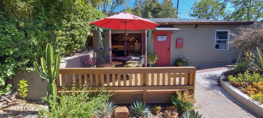 New large double doors in O'Shaughnessy's granny flat open onto a new front deck at the home in La Mesa.