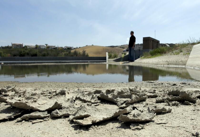 Rich Kissee, operations manager for the Santa Margarita Water District, stands on the edge of a water runoff reservoir in Rancho Santa Margarita, Calif., on July 2.