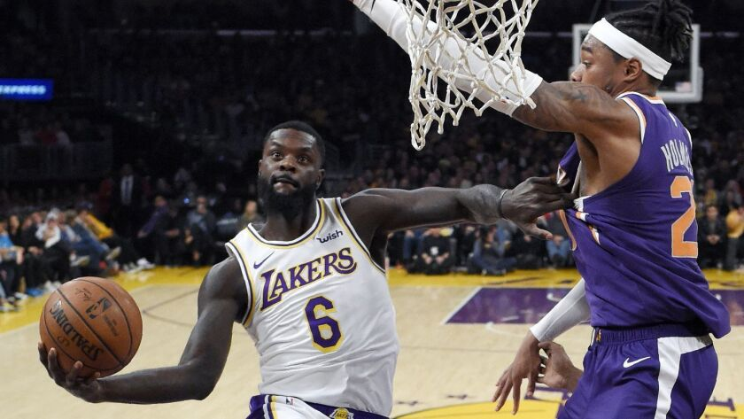 Lakers guard Lance Stephenson shoots as Phoenix forward Richaun Holmes defends on Jan. 27 at Staples Center.