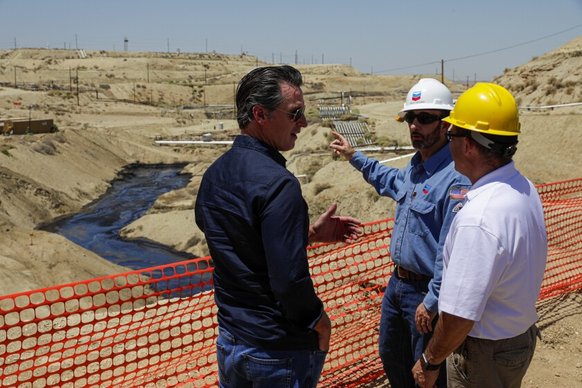 Gavin Newsom tours the scene of a million-gallon spill in Kern County.