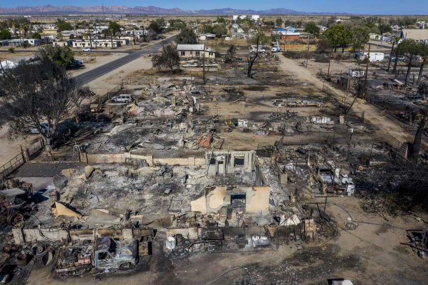 Blocks of homes on Third St. lay in ashes the day after high winds stoked a wildfire. (Robert Gauthier / Los Angeles Times)