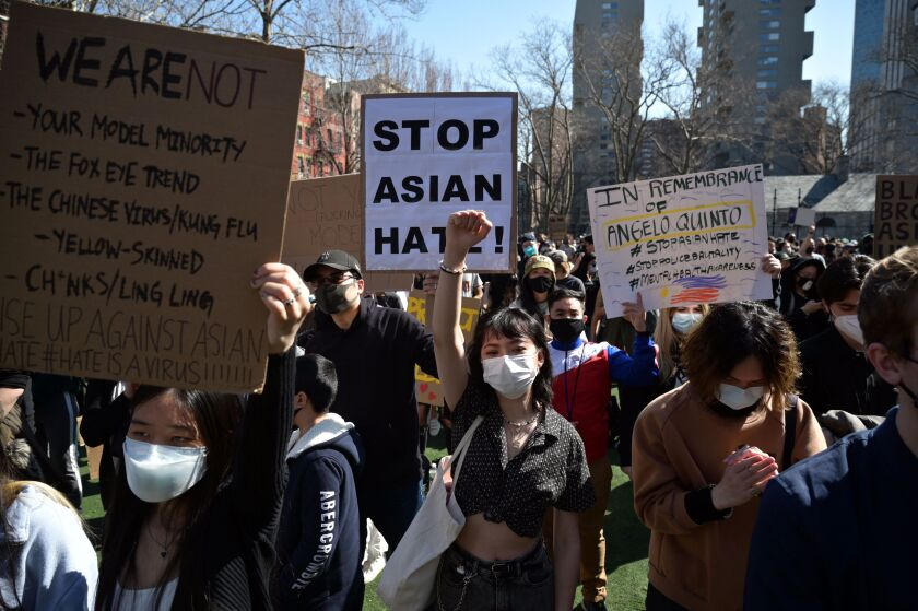 """Members and supporters of the Asian-American community attend a """"rally against hate."""""""