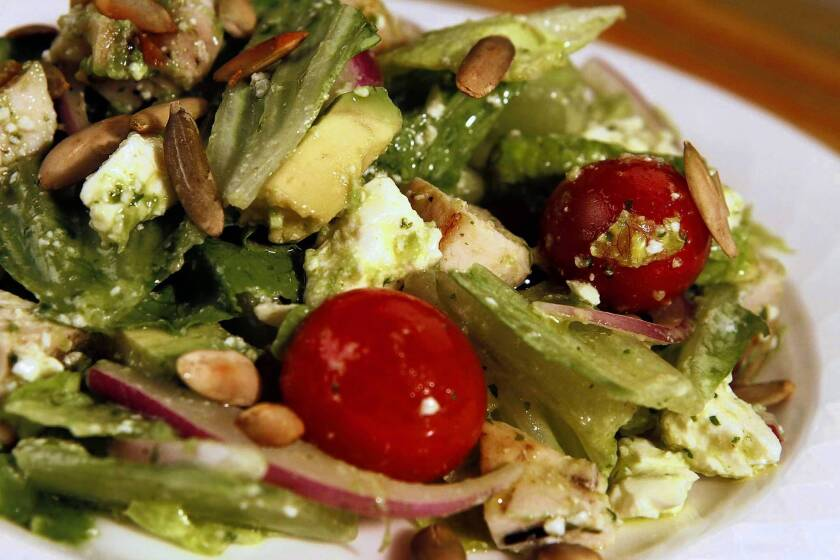 This simple salad is made with an avocado vinaigrette. Bluewater Grill's chicken chopped salad