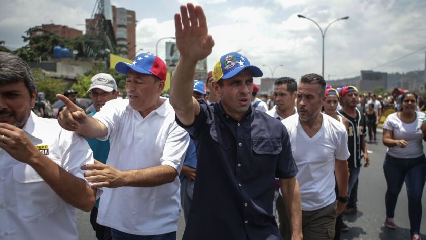 Miranda state governor and oposition leader, Henrique Capriles, leads a demonstration while hundreds of people protest in Caracas, Venezuela.
