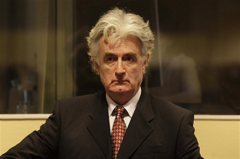 FILE - In this Aug. 29, 2008 file photo, former Bosnian Serb leader Radovan Karadzic is seen in the courtroom to enter pleas to 11 charges including genocide and crimes against humanity, at the U.N. Yugoslav war crimes tribunal in the Hague, Netherlands. Karadzic has been a psychiatrist, a poet, a leader of Bosnia's Serbs and a fugitive disguised as a new age guru. Now he has assumed yet another persona, a lawyer defending himself against charges of genocide and mass murder. (AP Photo/ Valerie Kuypers, Pool, file)