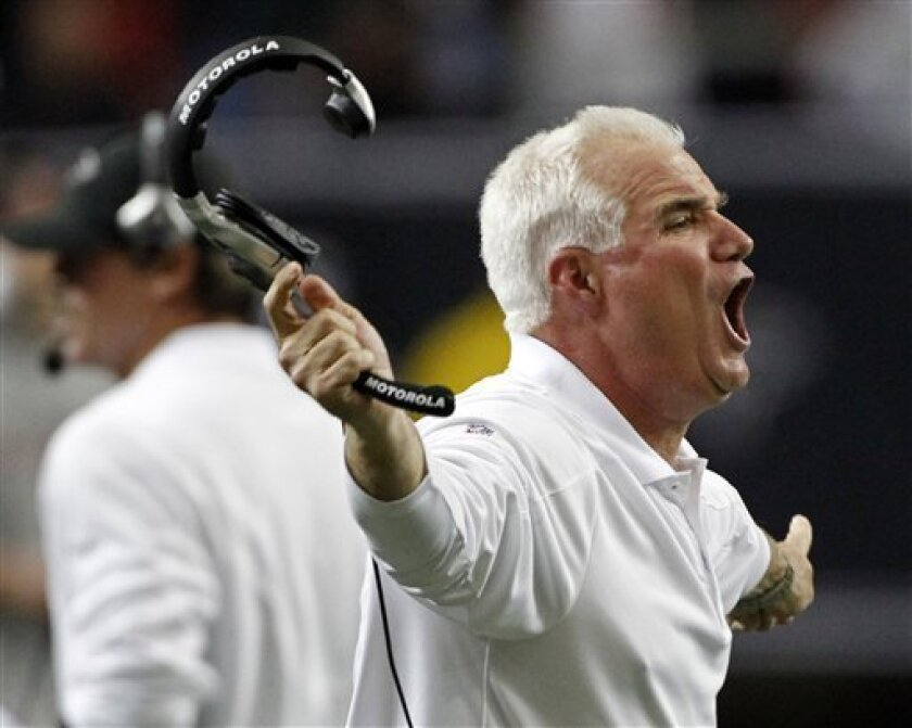 Atlanta Falcons head coach Mike Smith yells from the sideline in the fourth quarter of an NFL football game against the Tampa Bay Buccaneers in Atlanta Sunday, Nov. 7, 2010. Atlanta won 28-21. (AP Photo/John Bazemore)