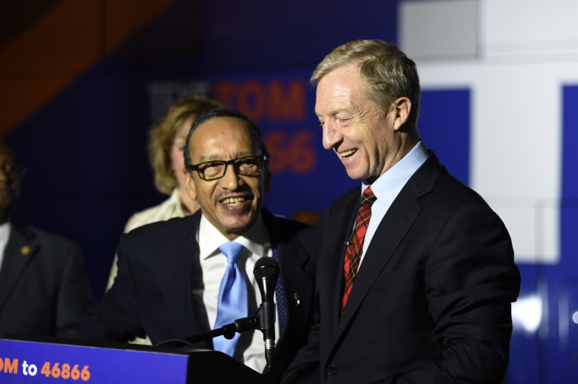 Tom Steyer receives the endorsement of the chairman of the South Carolina Democratic Black Caucus, Johnnie Cordero, in Florence, S.C.