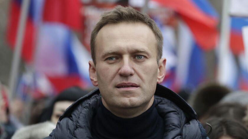 FILE - In this Sunday, Feb. 24, 2019 file photo, Russian opposition activist Alexei Navalny takes pa