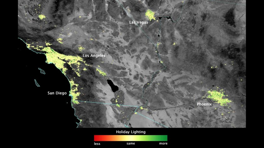 In this image from NASA, green denotes light that's brighter during the Christmas-New Year's season than during the rest of the year.