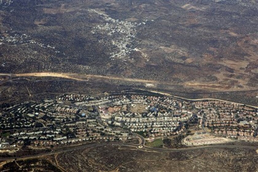 FILE - In this Sept. 20, 2010 aerial file photo, taken through the window of an airplane, the West Bank Jewish settlement of Ariel is seen. Israel's housing minister on Sunday, Aug. 11, 2013, gave final approval for building nearly 1,200 new settlement apartments on lands the Palestinians want for their state, just three days before U.S.-sponsored talks on the borders of such a state are to begin in Jerusalem. (AP Photo/Ariel Schalit, File)