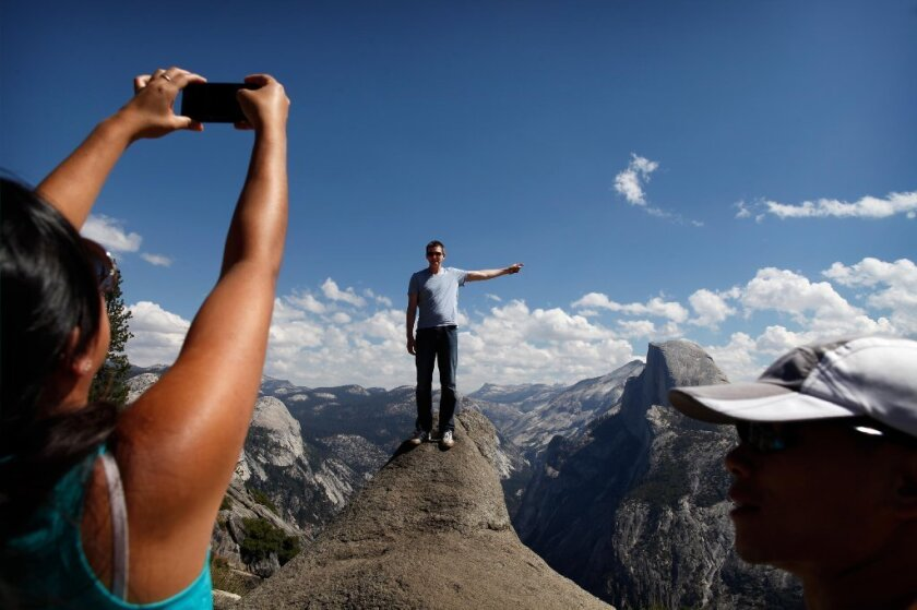 A friend snaps a picture of Norm Zalog in Yosemite National Park as the Rim fire burns about 25 miles away.