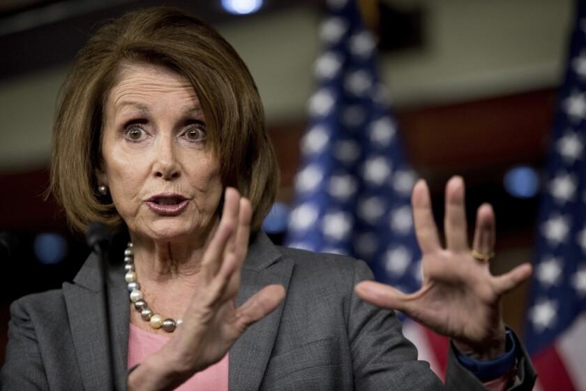 Nancy Pelosi gestures while talking.