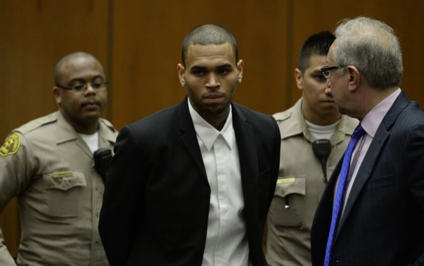 R&B singer Chris Brown, center, arrives in court. At right is his lawyer, Mark Geragos.