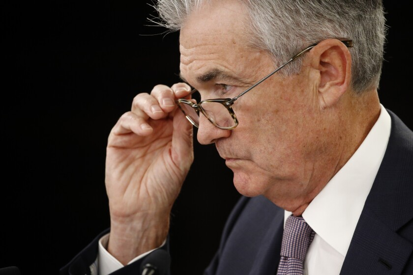 Federal Reserve Board Chairman Jerome H. Powell, shown at a news conference in September, announced Tuesday that the Fed is cutting its target for short-term interest rates by half a percentage point.
