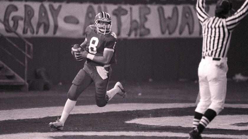 FOOTBALL---San Diego CA--December 7, 1985--Vista High School Sal Aunese (#8) during a game aginst He