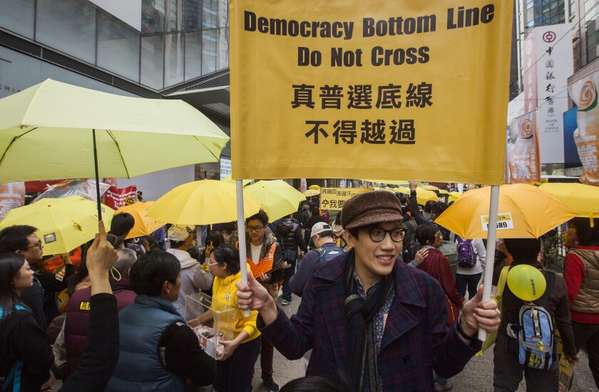 Hong Kong protesters march for democracy on Sunday, the first demonstration since police cleared the streets in December.