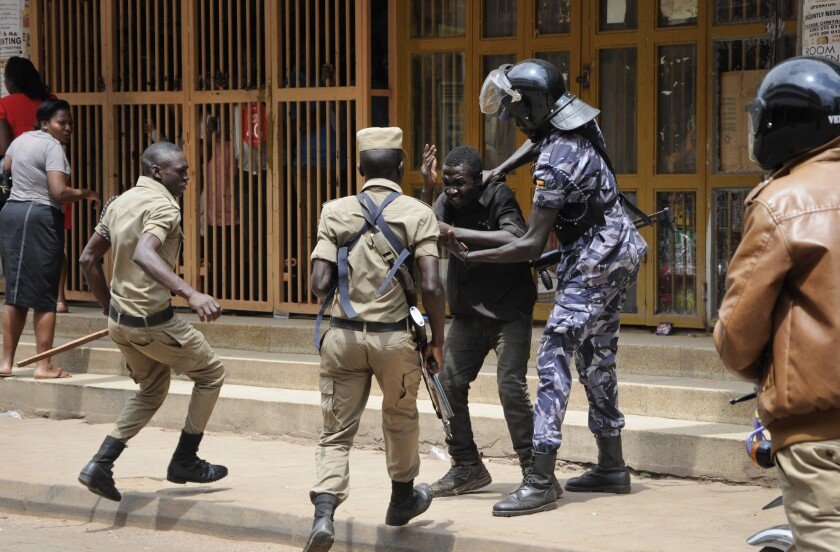FILE - In this Monday, Aug. 20, 2018 file photo, Ugandan security forces briefly beat then detain a