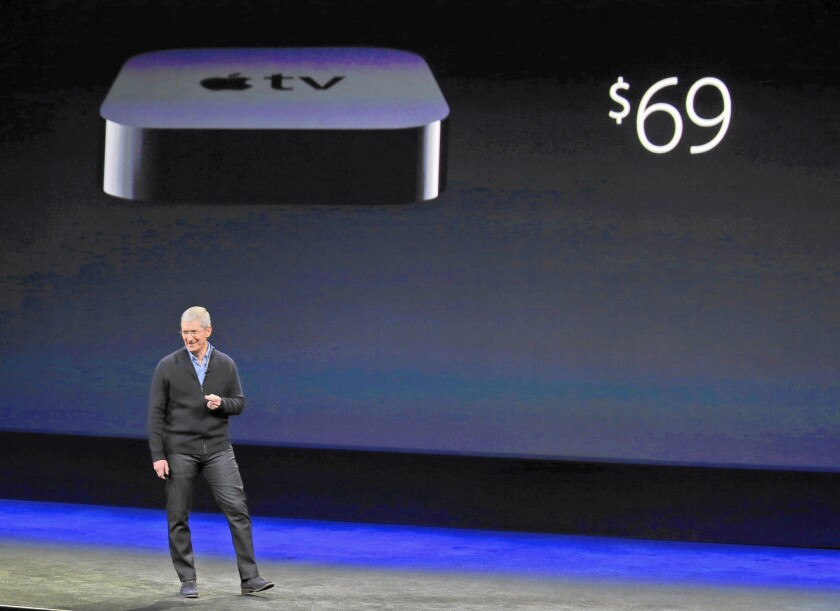 Apple CEO Tim Cook announces that the cost of the Apple TV device will drop to $69 from $99 during the tech giant's event in San Francisco last week. Some customers may use the device to replace their cable box.