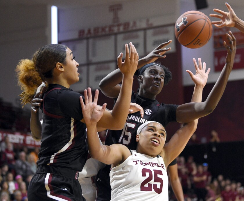 Temple's Mia Davis (25) battles for position against South Carolina's Breanna Beal, left, and Laeticia Amihere during the second half of an NCAA college basketball game, Saturday, Dec. 7, 2019, in Philadelphia. (AP Photo/Derik Hamilton)