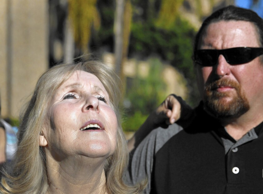 """I feel like I have wings now,"" Susan Mellen, with nephew David Mellen, said outside court in Torrance after a judge ruled she was factually innocent of a slaying for which she had served 17 years."