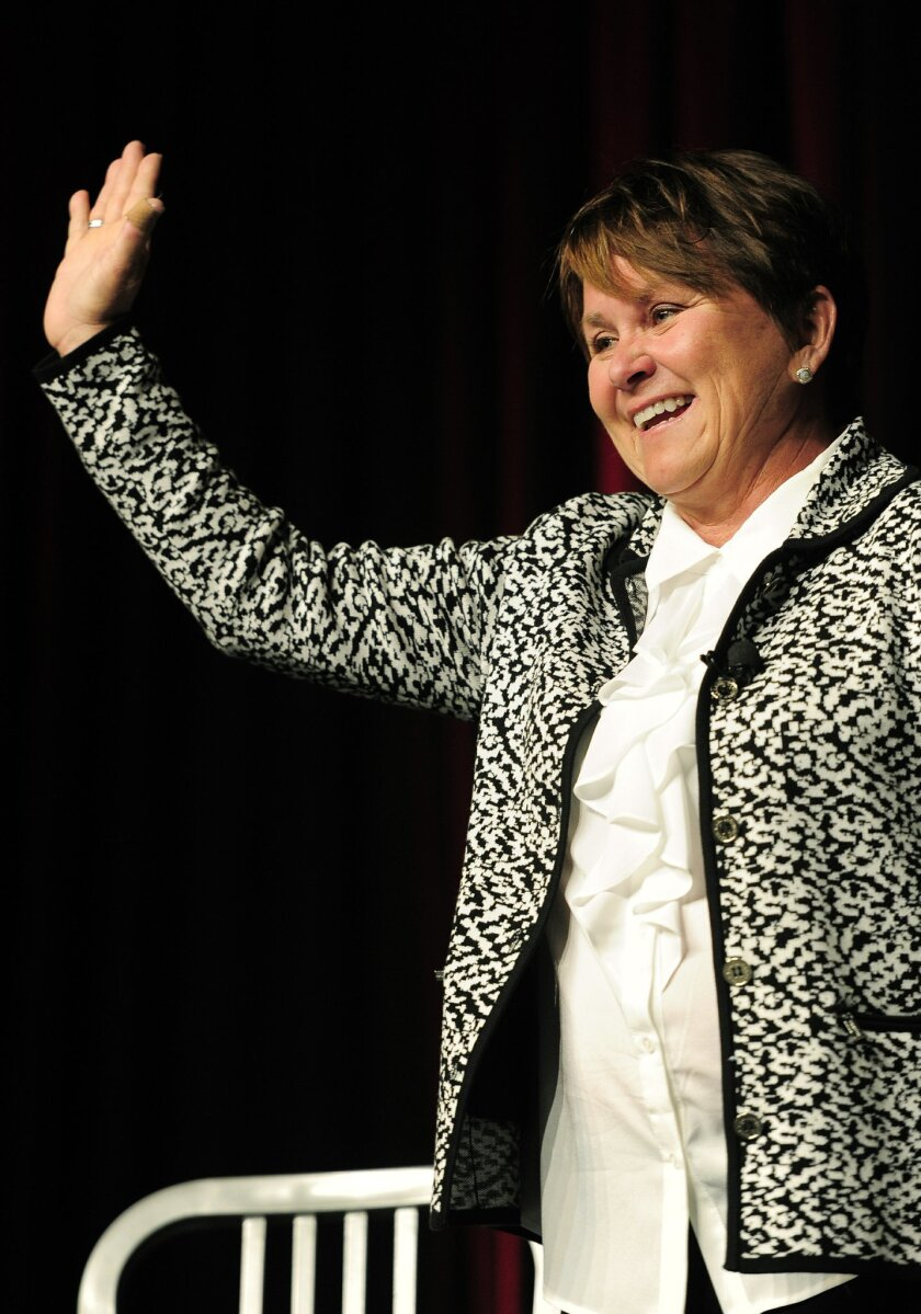 Tennessee Titans owner Amy Adams Strunk waves to fans after talking with Titans radio personality Mike Keith during a season ticket holder luncheon at the Music City Center Thursday Feb. 18, 2016, in Nashville, Tenn. Titans controlling owner Amy Adams Strunk wrapped up her first public appearance b