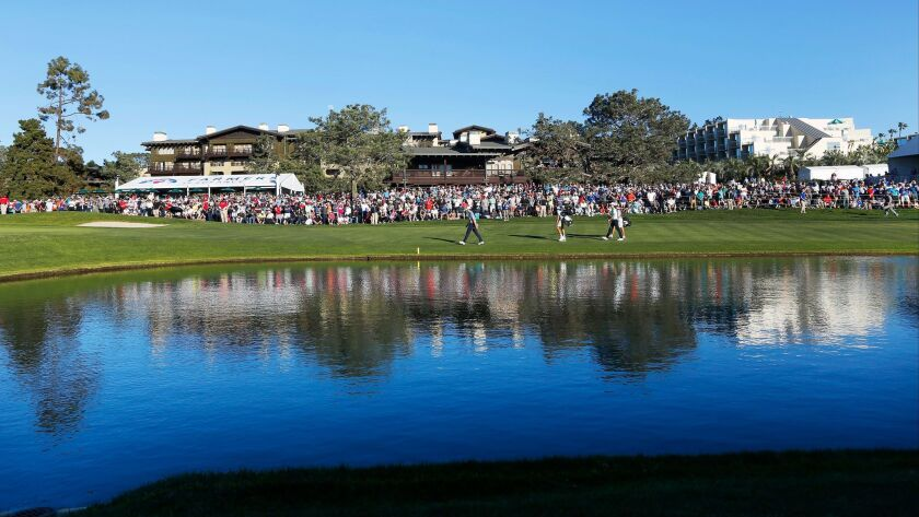 Fans look on at the 18th hole during the Farmers Insurance Open at the Torrey Pines Golf Course on Sunday.