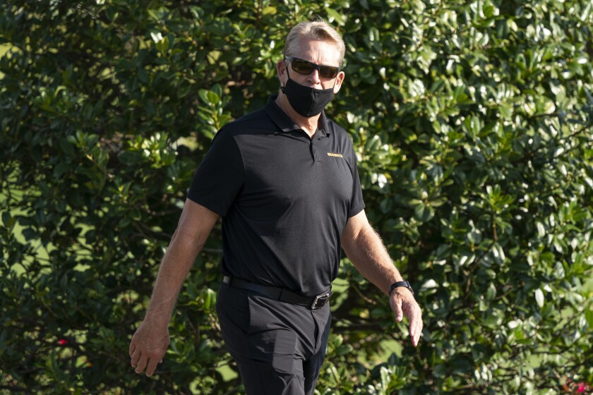 FILE - Washington defensive coordinator Jack Del Rio arrives for practice at the team's NFL football training facility, Thursday, Aug. 20, 2020, in Ashburn, Va. Washington Football coach Ron Rivera missed his team's first game-week practice Tuesday as he began treatment for a form of skin cancer. As planned, defensive coordinator Jack Del Rio stepped in and ran practice ahead of Washington's game against the Philadelphia Eagles. (AP Photo/Alex Brandon, File)