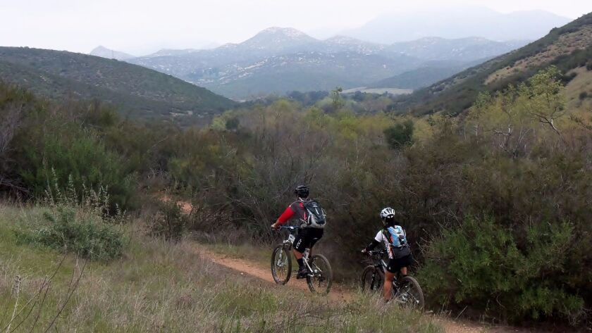 Mountain bikers traverse the Stowe Trail in 2014. The trail linking Poway to Santee has been closed for several years but is set to reopen soon.