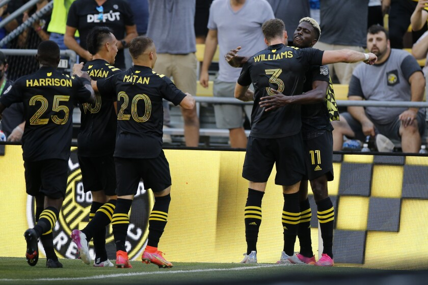 Columbus Crew players celebrate their goal against the Chicago Fire during the first half of an MLS soccer match Saturday, June 19, 2021, in Columbus, Ohio. (AP Photo/Jay LaPrete)