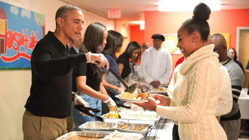 President Barack Obama and family serve Thanksgiving meals to homeless and at-risk veterans at Friendship Place in Washington, D.C. in November 2015.