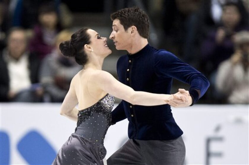 Tessa Virtue and Scott Moir, of Canada, perform in the ice dance short program at the World Figure Skating Championships, Thursday, March 14, 2013, in London, Ontario. (AP Photo/The Canadian Press, Paul Chiasson)