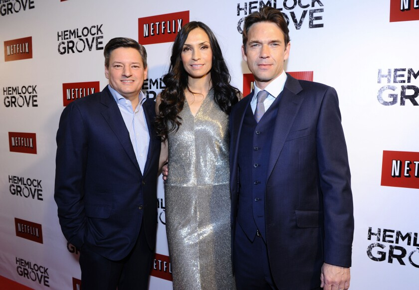 """Netflix Chief Content Officer Ted Sarandos, left, was named to Time's list of the 100 most influential people in the world. He appears with actress Famke Janssen, center, and actor Dougray Scott, at the North American premiere of the latest Netflix original series, """"Hemlock Grove."""""""