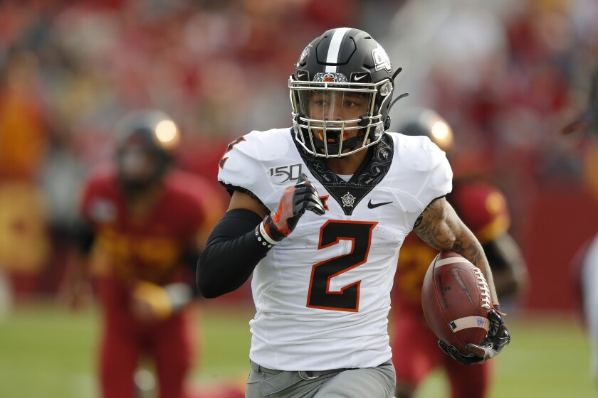 Oklahoma State wide receiver Tylan Wallace breaks free from Iowa State defense to score a touchdown during the first half of an NCAA college football game, Saturday, Oct. 26, 2019, in Ames, Iowa. (AP Photo/Matthew Putney)