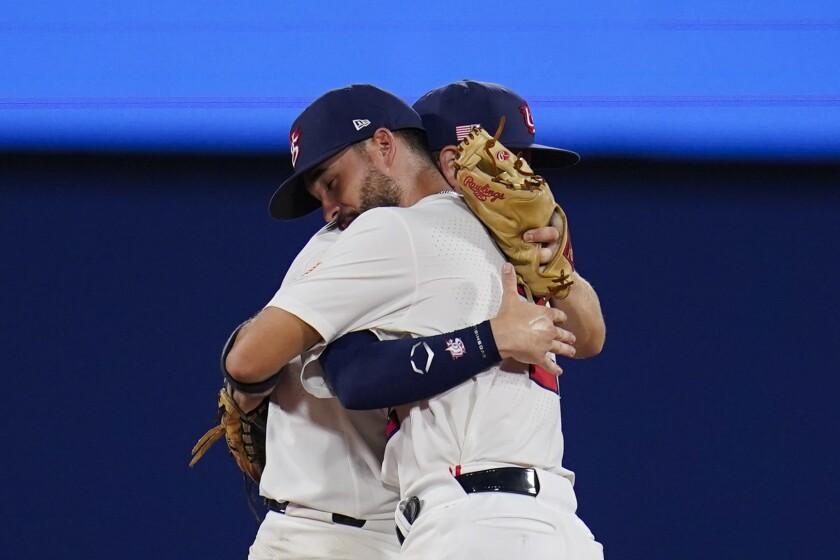 United States' Eddy Alvarez, front, and Nick Allen embrace