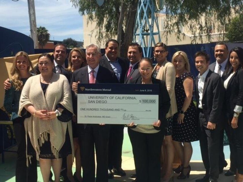 Representatives from Northwestern Mutual in La Jolla, Carlsbad and San Diego present a $100,000 check to Dr. Paula Aristizabal's UCSD La Jolla Research Institution for two-year funding of pediatric cancer research.