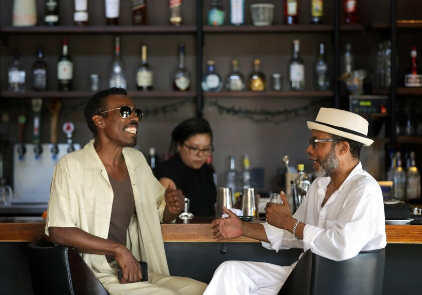 Brad Patterson, left, and Reggie Dunn chat in the bar at Post & Beam