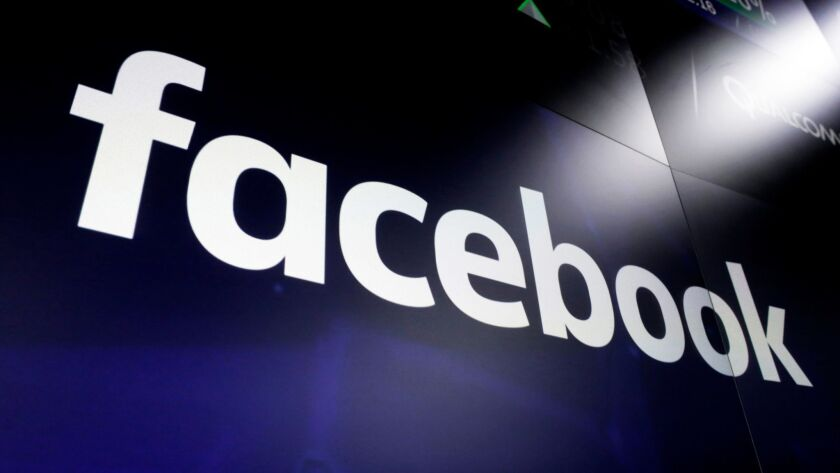 FILE - In this file photo dated March 29, 2018, the logo for social media giant Facebook, appears o