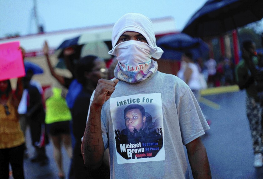 A protester in Ferguson wears a shirt bearing Michael Brown's image.