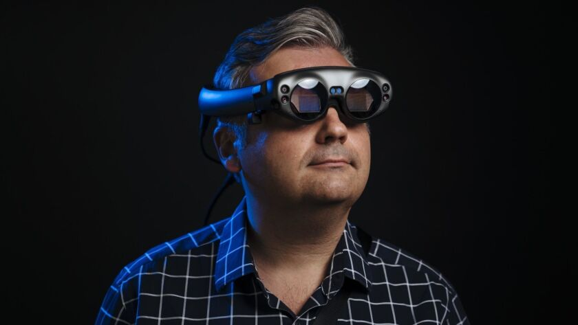 Washington Post technology columnist Geoffrey Fowler looks through the Magic Leap One.