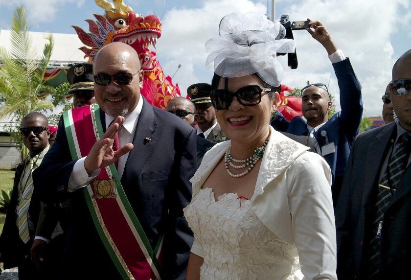 Suriname President Desire Delano Bouterse arrives to his second term inaugural ceremony with his wife, first lady Ingrid Bouterse-Waldring, in Paramaribo, Suriname, Wednesday, Aug. 12, 2015. A two-time coup leader and former dictator accused of executing 15 political opponents in 1982, Bouterse obt