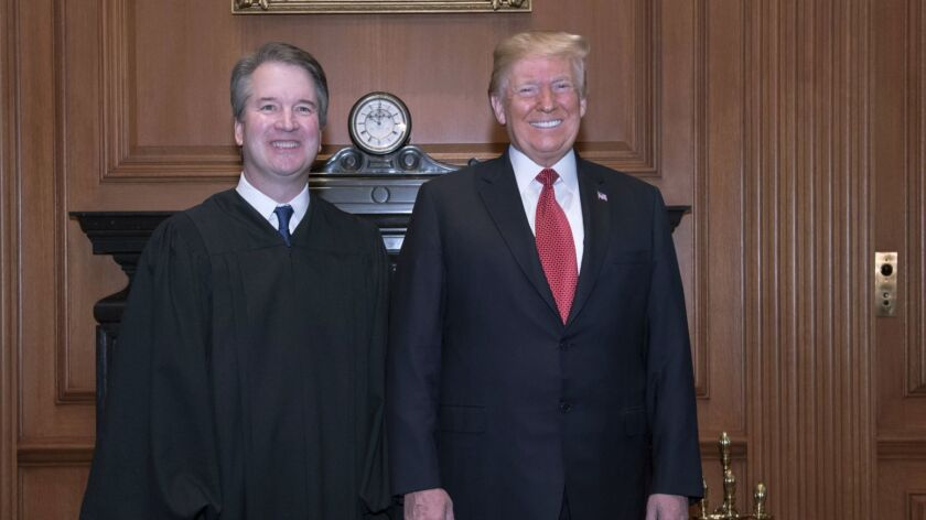 President Trump and Justice Brett M. Kavanaugh in the Justices' Conference Room before an investiture ceremony Thursday.
