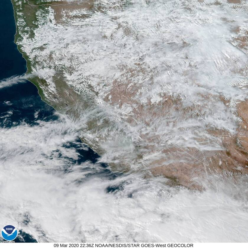 The leading edge of clouds from a late winter storm are moving into San Diego County.
