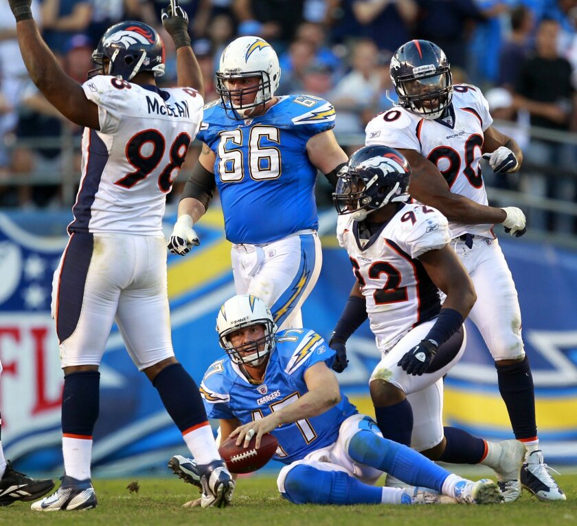 Chargers Philip Rivers gets up after getting hit in the 4th quarter against the Broncos on Sunday, Nov. 27, 2011.