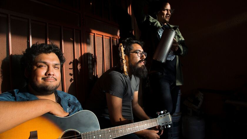 Thee Commons band members, from left, David Pacheco, Jose Rojas and Rene Pacheco. The Boyle Heights band is one of several Latino bands set to play at the 2017 Coachella Music and Arts Festival.