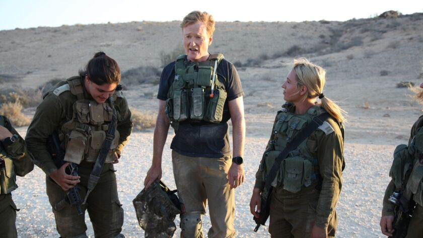 "Conan O'Brien, center, in ""Conan Without Borders: Israel "" on TBS."