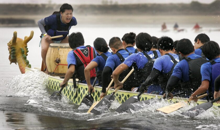 Jacqueline Chen of the UCSD dragon boat team yells commands as the caller during the races on Mission Bay.
