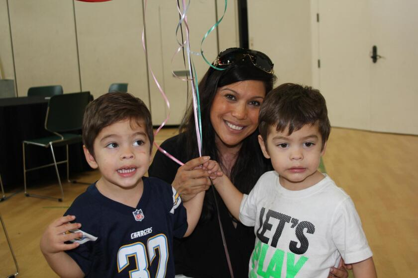 Twins Xander and Alex Fioroni with mom Ingrid.